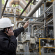 Oil refinery engineer - Stock Photo
