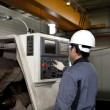 Stock Photo: Mechanical technician of cnc machine