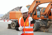 Portrait of road construction worker with heavy equipment — Stock Photo