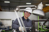 Asian male technician at tool workshop — Stock Photo