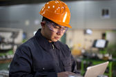 Technician at work in factory — Stock Photo