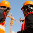Site manager with safety vest discussion under construction — Stock Photo