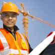 Portraite site manager with safety vest under construction — Stock Photo