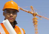 Close up site manager with safety vest under construction — Stock Photo