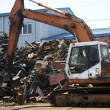 Industrial heap of  metal and excavator — Stock Photo