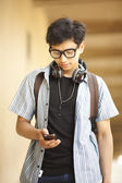 College student with mobile phone — Stock Photo