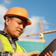 Construction worker using digital tablet — Stock Photo #30915029