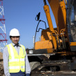 Digger standing beside excavator — Stock Photo