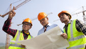 Group asian architect discussion front of a building site — Stock Photo