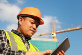 Construction worker using digital tablet — Stock Photo