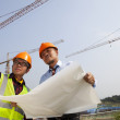 Young asian architects discussion front of construction site — Stock Photo