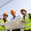 Group architect discussion front of a building site — Stock Photo