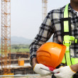 Close up construction worker holding helmet — Stock Photo #30933265