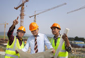 Architect and construction workers discussion on site — Stock Photo