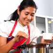 Young woman cooking in the kitchen — Stock Photo