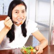 Girl eating vegetable  salad — Photo