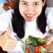 Smiling asian woman enjoying a fresh healthy salad — Stock Photo