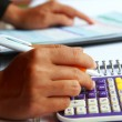 Business concept hand analyzing financial data — Stock Photo #41668355