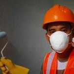 Постер, плакат: Painter worker wearing safety work on job