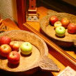 Apples in a wooden bowl near the mirror - Stock Photo