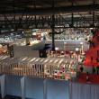 Panoramic view of people visiting home accessories and furnishing stands - Stock Photo