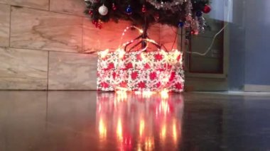Christmas gifts under the tree, lights effects — Stock Video