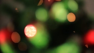 Colored lights effects, Christmas tree background — Stock Video