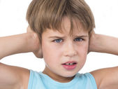 Boy with hands on his ears — Stock Photo