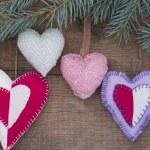 Textile hearts on the tree — Stock Photo