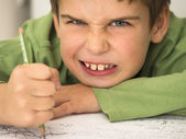 Boy hated doing his homework — Stock Photo