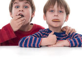 Two boys eating cookies — Stock Photo