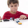 Boy playing with little cars — Stock Photo #19210457
