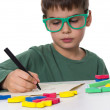 Stock Photo: Young boy writing his homework