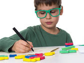 Young boy writing his homework — Stock Photo