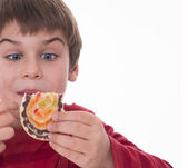 Boy eating, piece of tasteful cake — Stock Photo