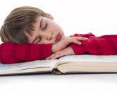 Boy asleep while learning — Stock Photo
