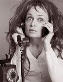 Woman with old phone and mobile — Stock Photo