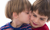 Younger brother kisses the older — Stock Photo
