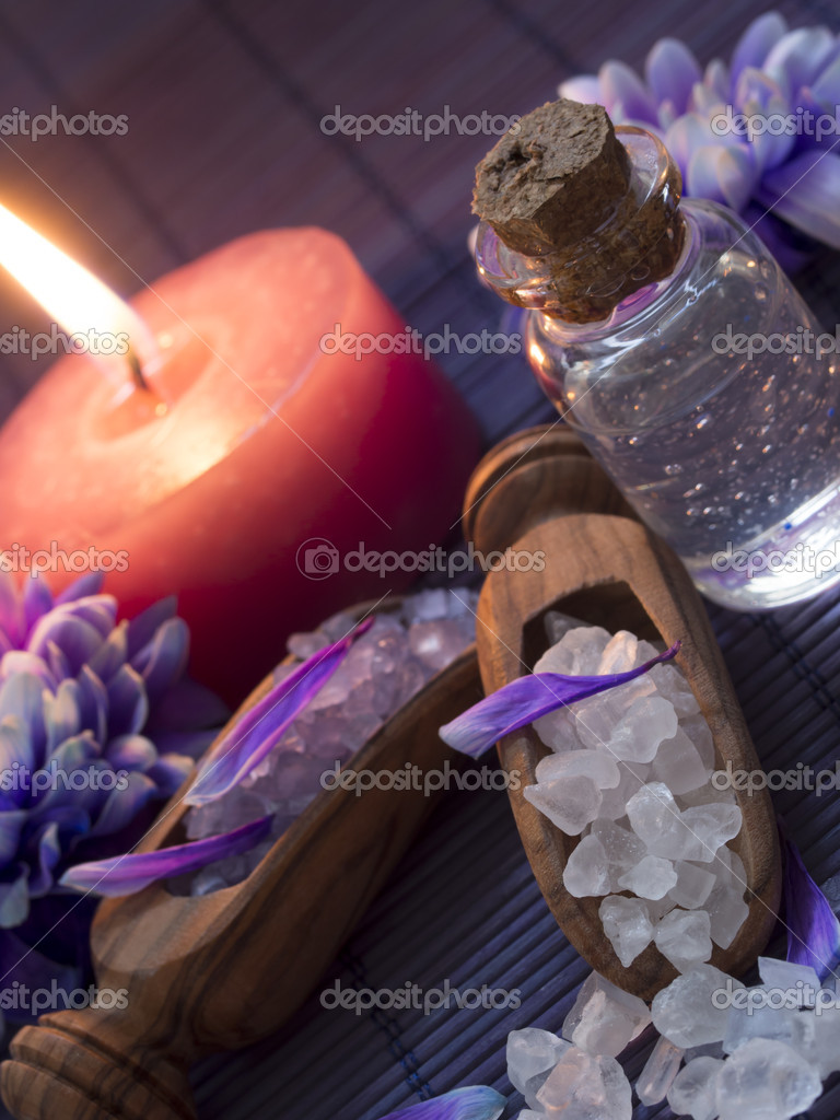 With salt and candle in the background  Stock Photo #19224087