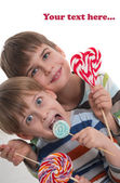 Happy boys with lollipops — Stock Photo