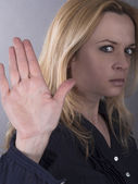Confident woman showing stop gesture sign with hand — Stock Photo