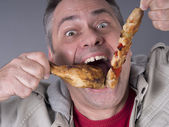 Hungry meat-eating man, no diet — Stock Photo