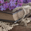 Vintage book in the floral arrangement — Stock Photo
