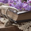 Vintage book in the floral arrangement - Stock fotografie
