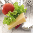 Fresh vegetables with cheese on the fork, diet concept — Stock Photo