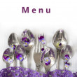 Silverware with violets — Stock Photo