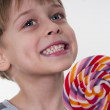 Smiling boy with lollipop — Stock Photo