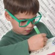 Young boy doing his homework  — Foto Stock