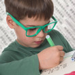 Young boy doing his homework — Stock Photo