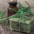 Bar of soap with rosemary — Stock Photo